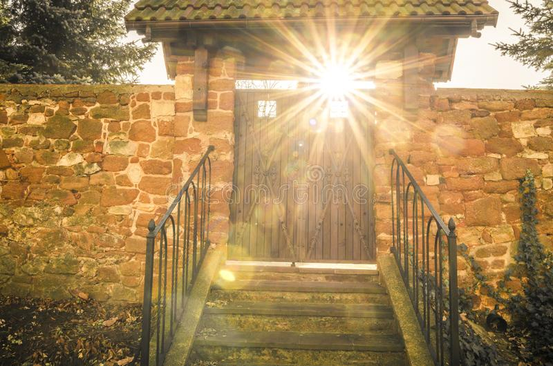Old wooden gate with sun rays shining through royalty free stock images