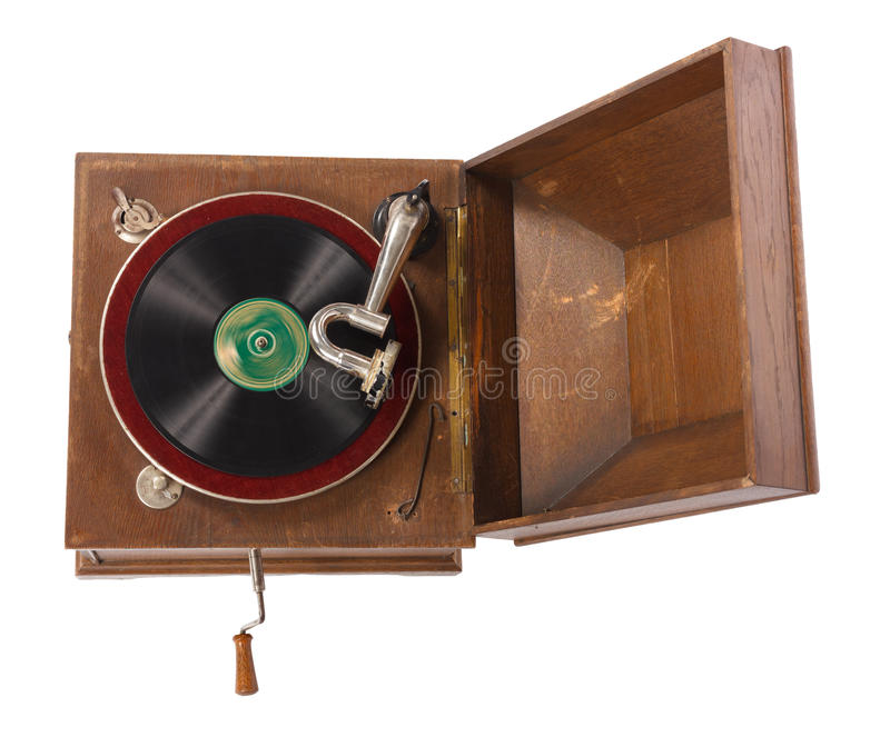Old wooden gramophone against white background