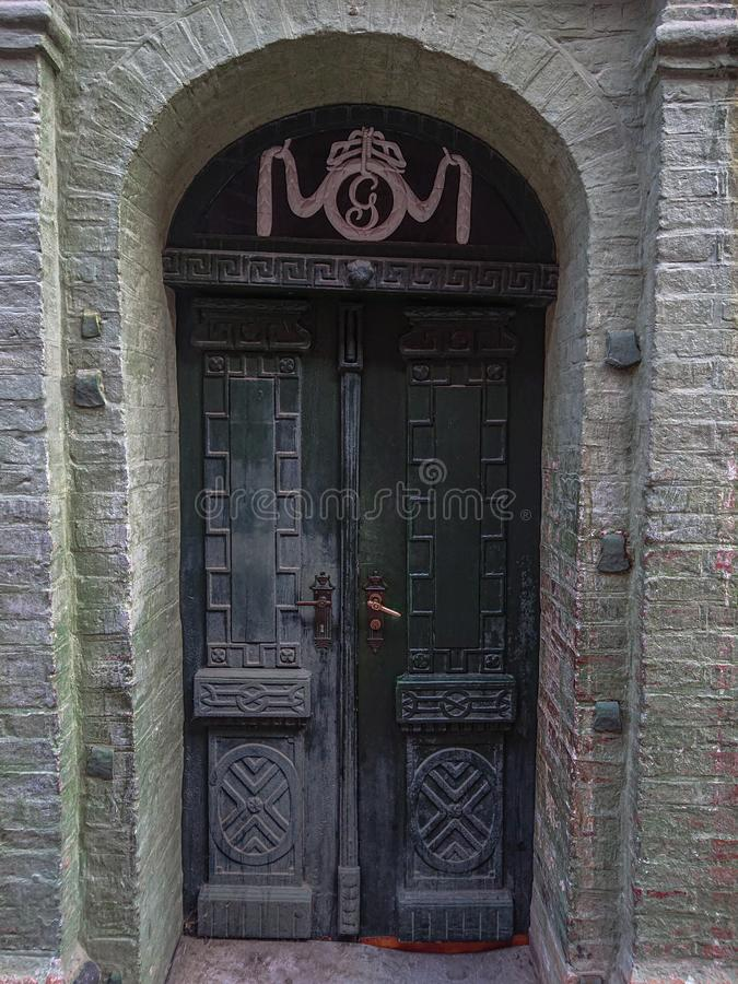 Old wooden green door in city. Brick, building, ancient, wall, front, open, closed, travel, citt, life, town royalty free stock photo