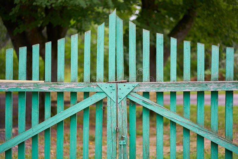 Old  wooden green gate to the courtyard stock image