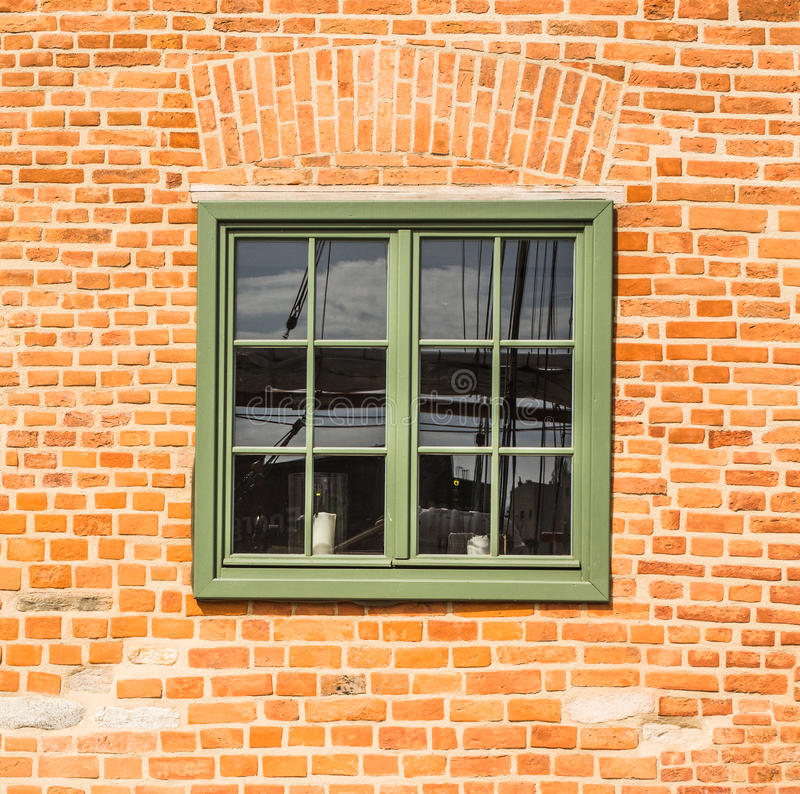 Old wooden green window in a brick wall royalty free stock photography