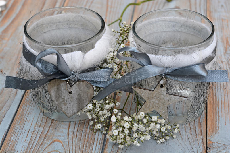 Old wooden grey shelves with grey white Christmas wooden decoration. Such as heart shape and star and candles holder decorated with baby's breath flowers stock images