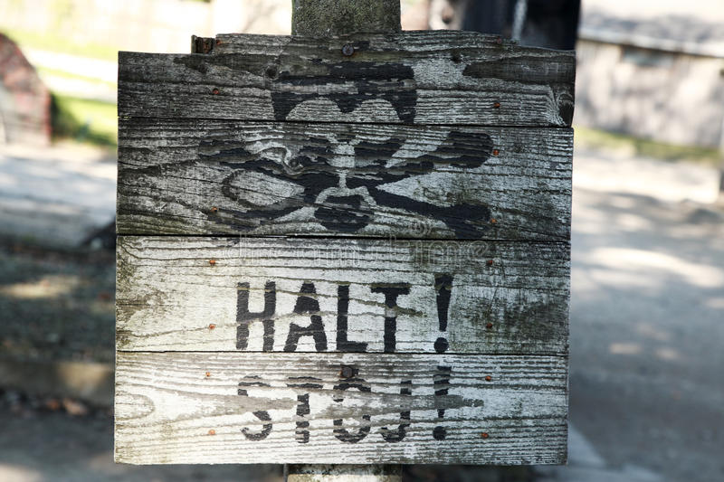 Old wooden halt sign, Auschwitz royalty free stock image