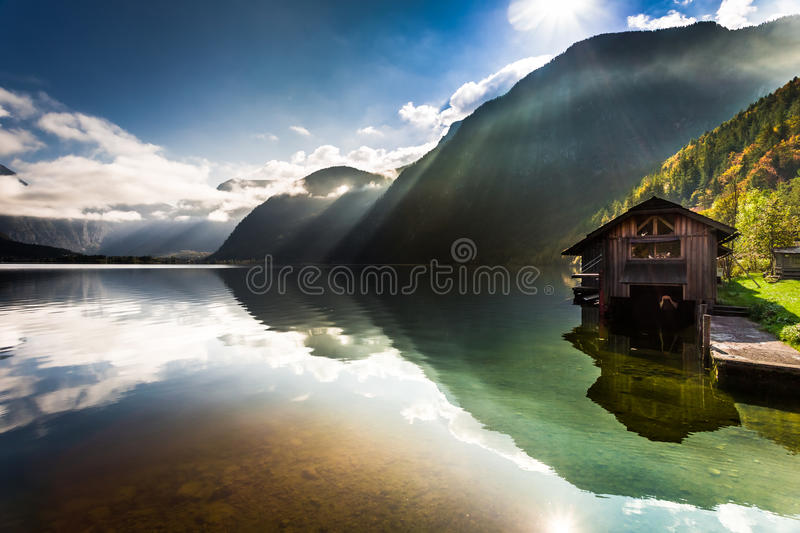 Old wooden haven at mountain lake stock photography