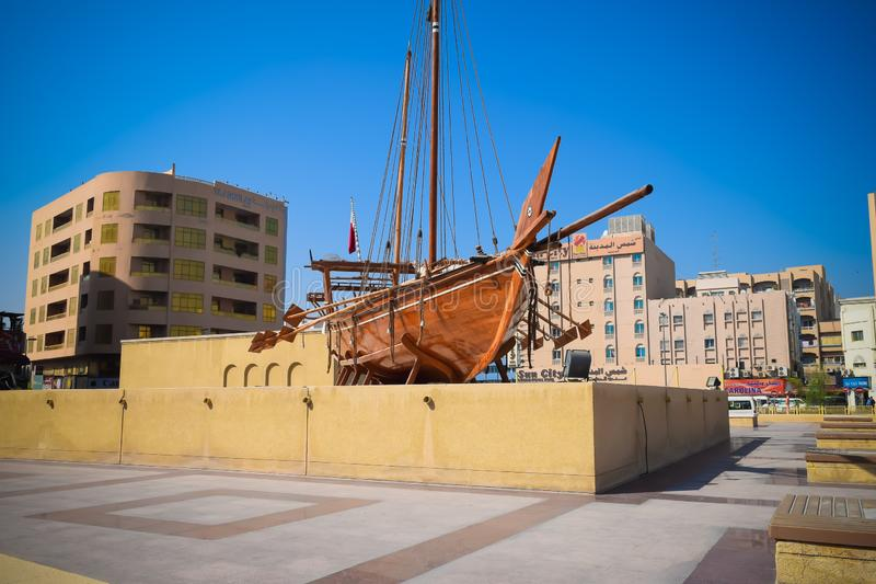 Old wooden boat called a Dhow outside the Dubai museum in UAE stock photos