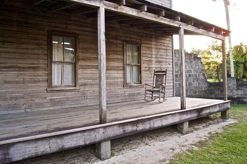 Old wooden home with rocking chair royalty free stock images