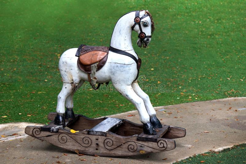 Old wooden horse white in the garden, Vintage retro toy wooden rocking horse royalty free stock images
