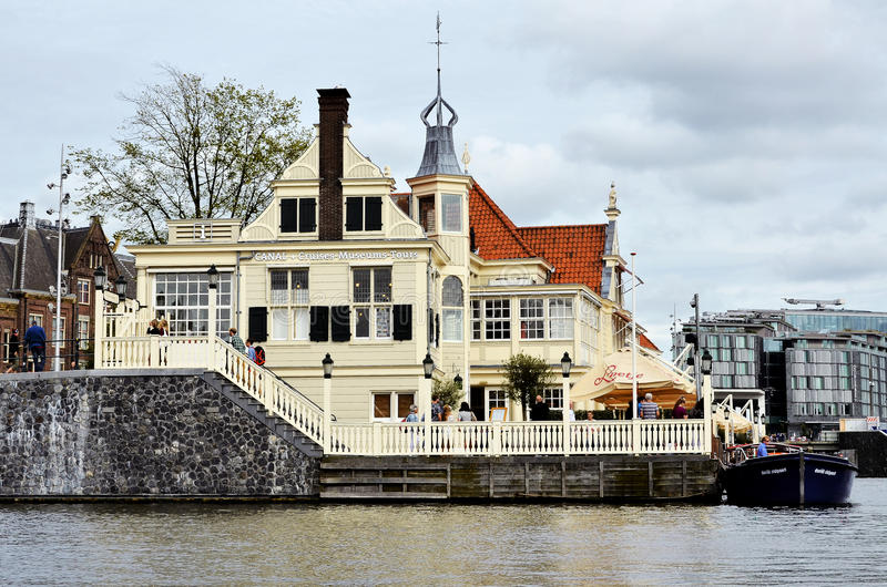 Old wooden house in Amsterdam. Old wooden house near a canal in Amsterdam stock photos