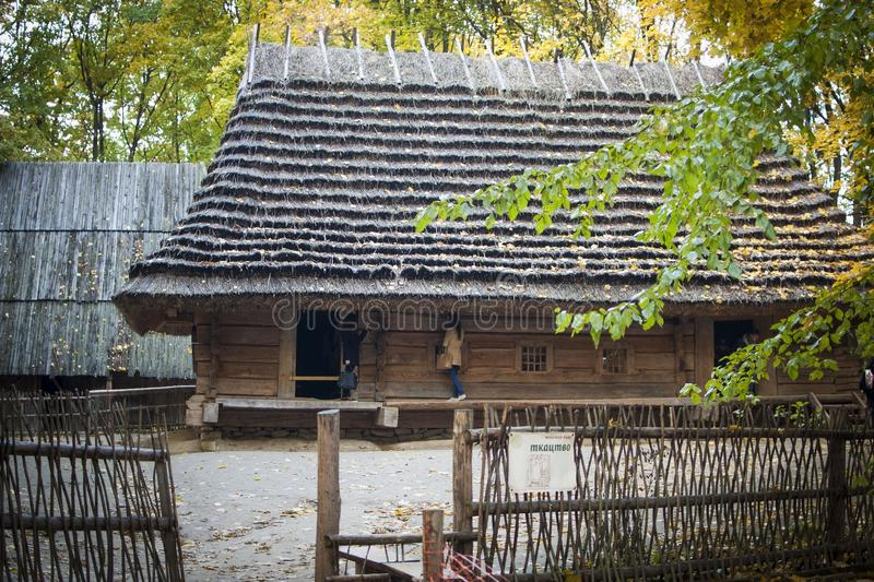 Old wooden house in autumn park stock photo