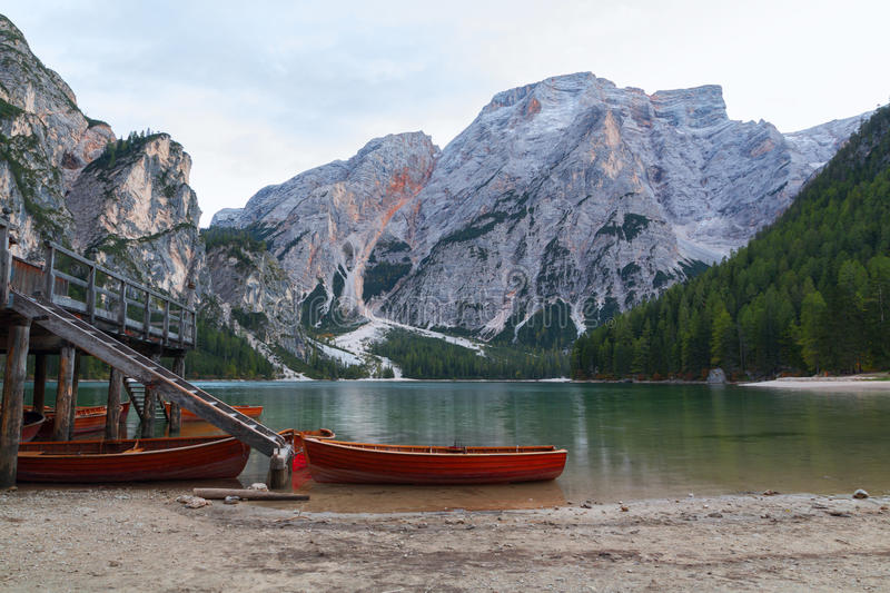 Old wooden house on the Braies lake in the background of Seekofel mountain. In Dolomites,Italy Pragser Wildsee royalty free stock photography
