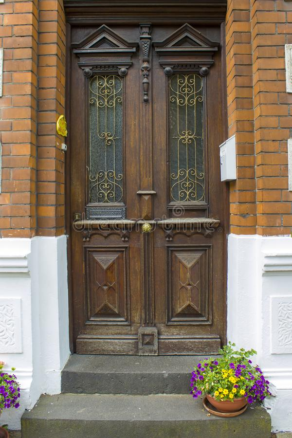 Old wooden house door in German small town, Geldern. North-Rhine Westphalia, Germany stock photos