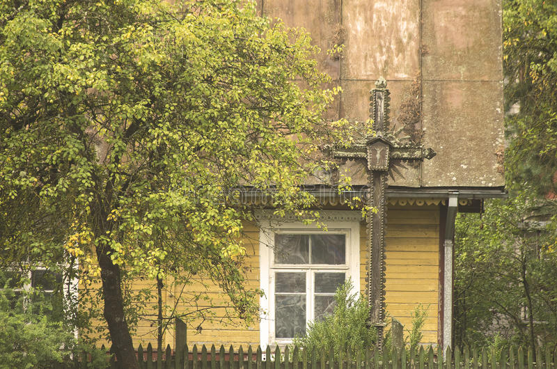 Old wooden house facade and a cross royalty free stock images