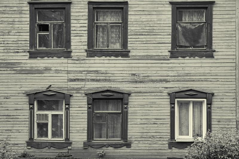 Old wooden house facade with six beautiful windows stock photos
