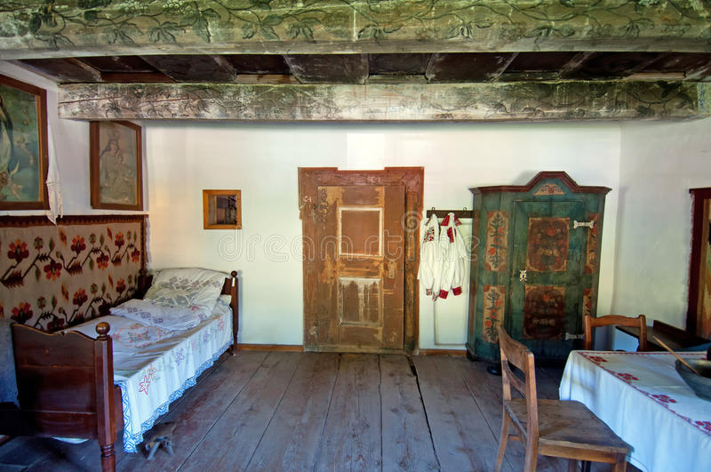 Old Wooden House Interior. View of historic interior in an old wooden house in one of the oldest Polish open air museum in Pstrazna, Poland royalty free stock photography