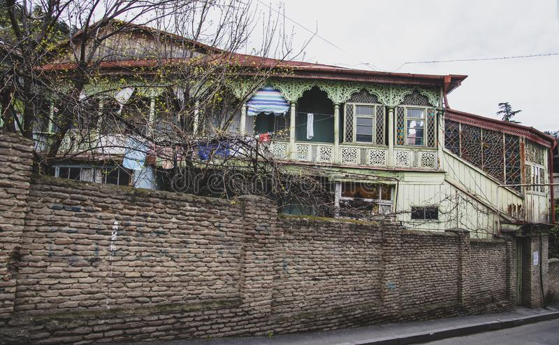 Old wooden house with mosaic windows of Tbilisi. TBILISI / GEORGIA - MARCH 30, 2018: Old wooden house with mosaic windows of Tbilisi, Georgia stock image