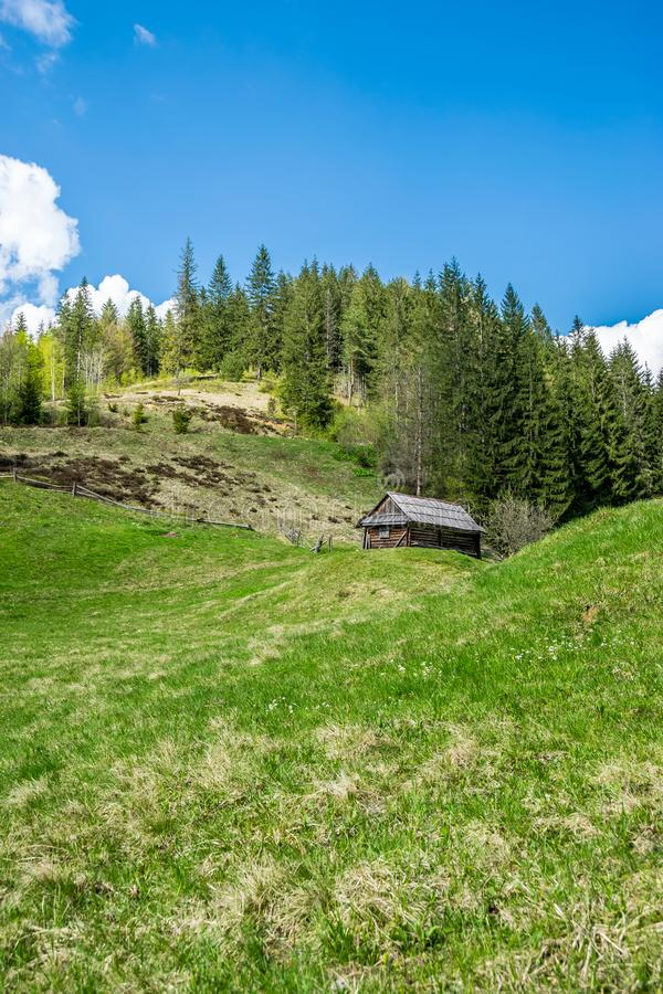 Old wooden house in mountains royalty free stock photo