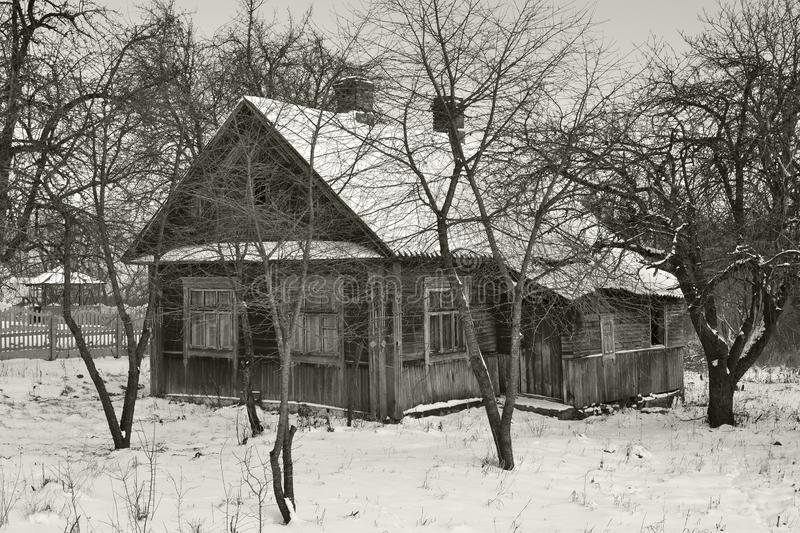 Old wooden abandoned house in russian viillage, monochrome image in retro style. Old wooden house in russian viillage, monochrome image in retro style royalty free stock photos