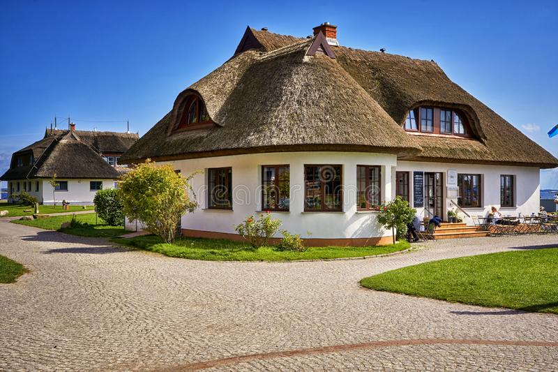 Old wooden houses with reed roofs in Hiddensee. Architecture, background, building, country, culture, garden, green, home, landscape, rural, germany, kloster royalty free stock photo