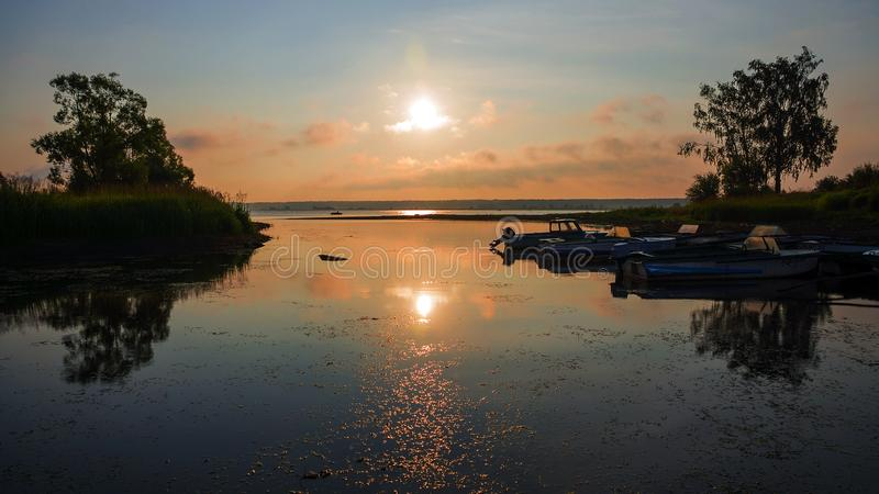 Old wooden jetty with boats (sunrise).  stock image