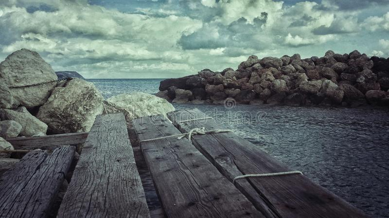 Old wooden jetty in winter stock image