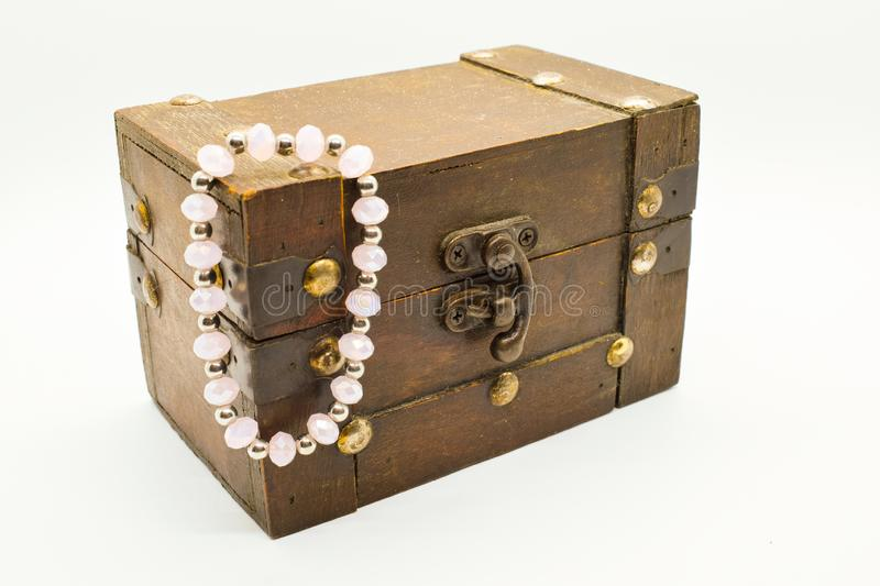 Old wooden jewelry chest with bracelet isolated on white background. Treasure gold closeup box accessory coin furniture antique decorative design brown royalty free stock photos