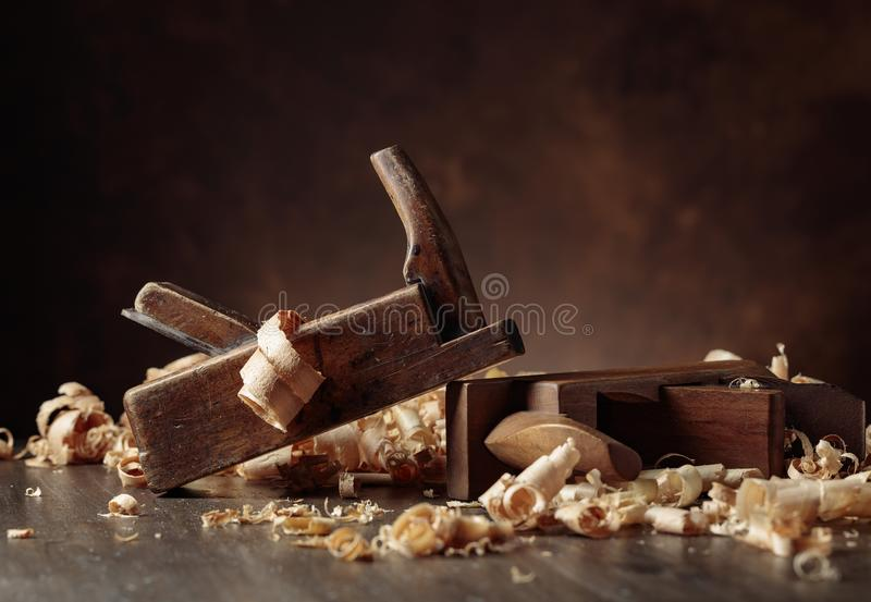 Old wooden jointers and shaving on wooden table royalty free stock image