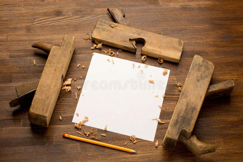 Old wooden jointers on the wood table with grunge. Texture royalty free stock photos