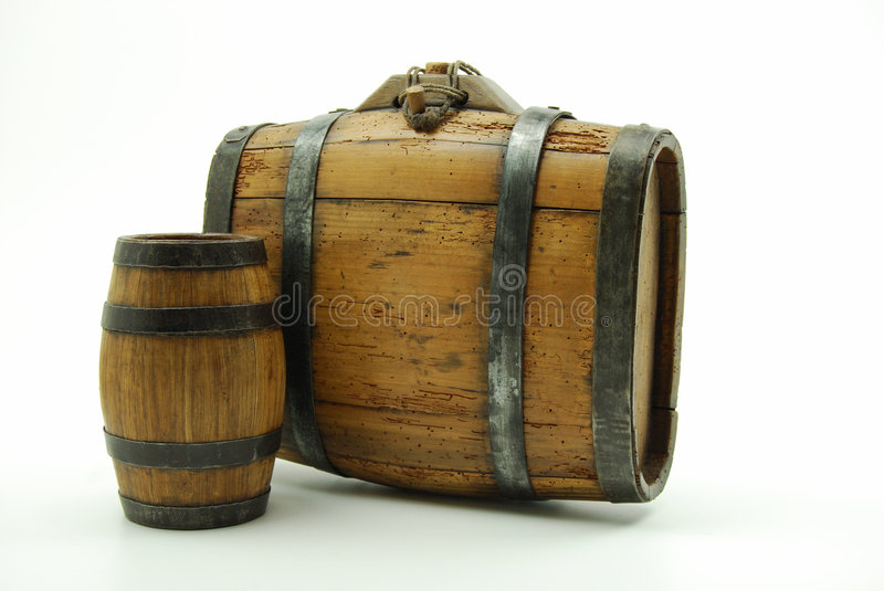 Old wooden kegs. Antique wooden kegs used by farmers to carry their wine to drink, while working in the fields, much like today's office worker carries a thermos royalty free stock images