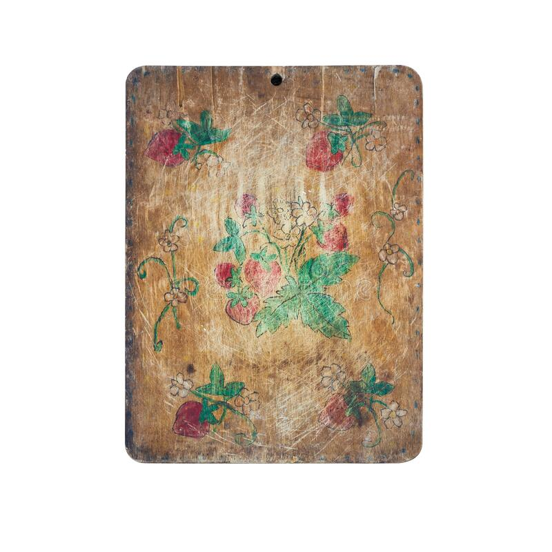 Old wooden kitchen cutting board decorated with children pattern.  royalty free stock images