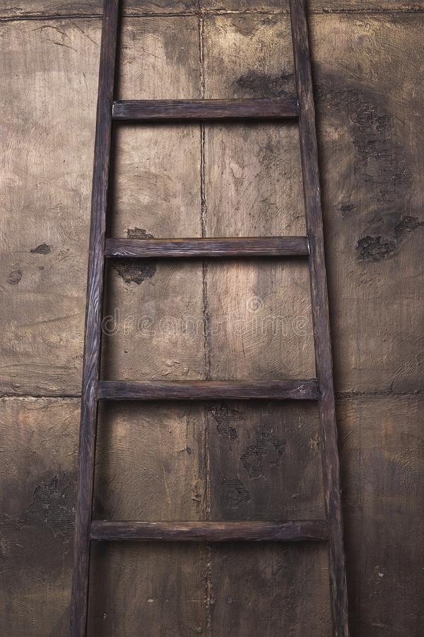 Old wooden ladder over the wall background royalty free stock photos