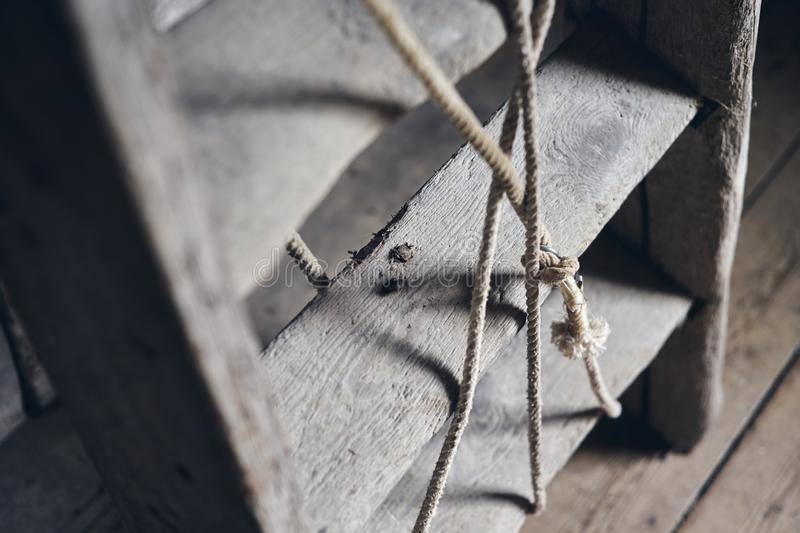 Old wooden ladder. Selective focus on ladder step. Close up royalty free stock photo