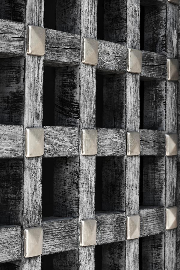 Old wooden lattice in the interior of the castle royalty free stock photo