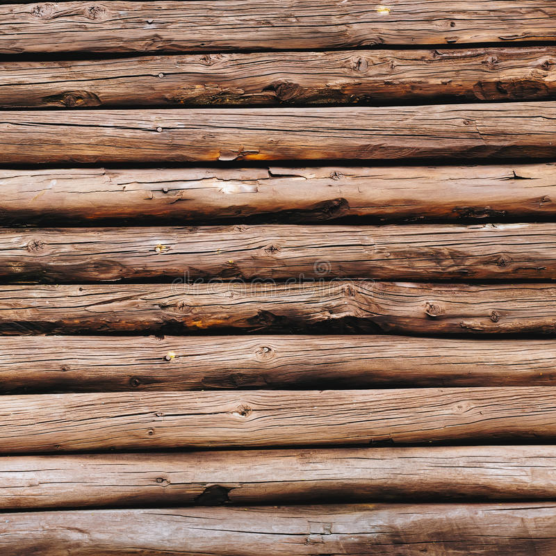 Old wooden logs background. Weathered wooden wall in brown color. stock photography