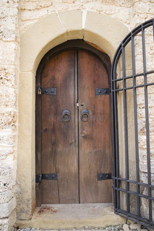Old wooden massive door on church stock photo