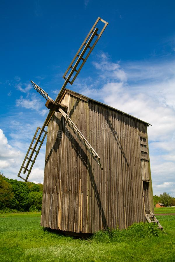 Old wooden mill on the background of beautiful nature. stock images