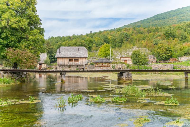 Old wooden mill and bridge at gacka river in central croatia royalty free stock photos
