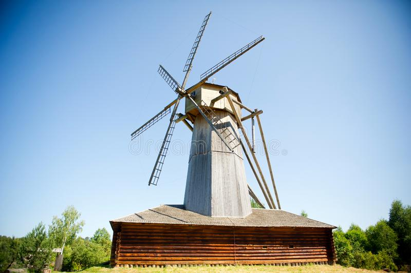 Old wooden mill in the village stock photos