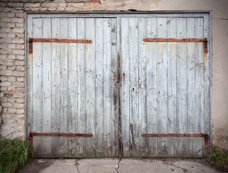 Old wooden neglected garage door.  stock photo