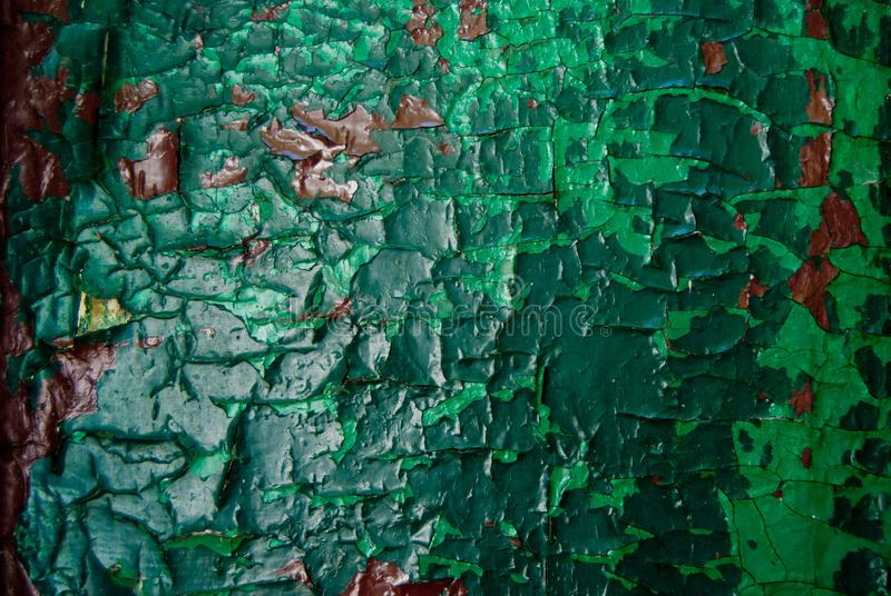 Old wooden painted green and brown rustic background. texture of paint peeling off stock photos