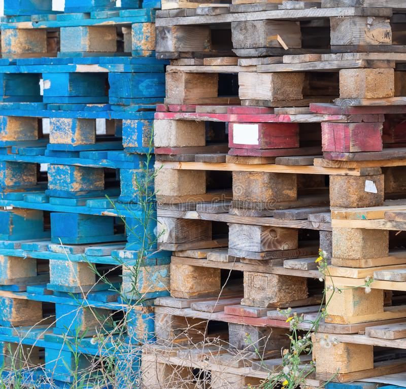 Old wooden pallets from cargo, shipping. Discarded, stacked. royalty free stock photo