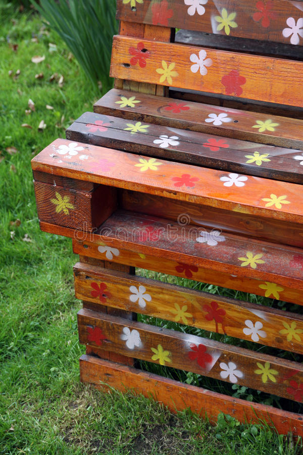 Old wooden pallets and garden furniture. From old wooden pallets can made an interesting garden furniture. When painting wood used natural colors and let your stock photography