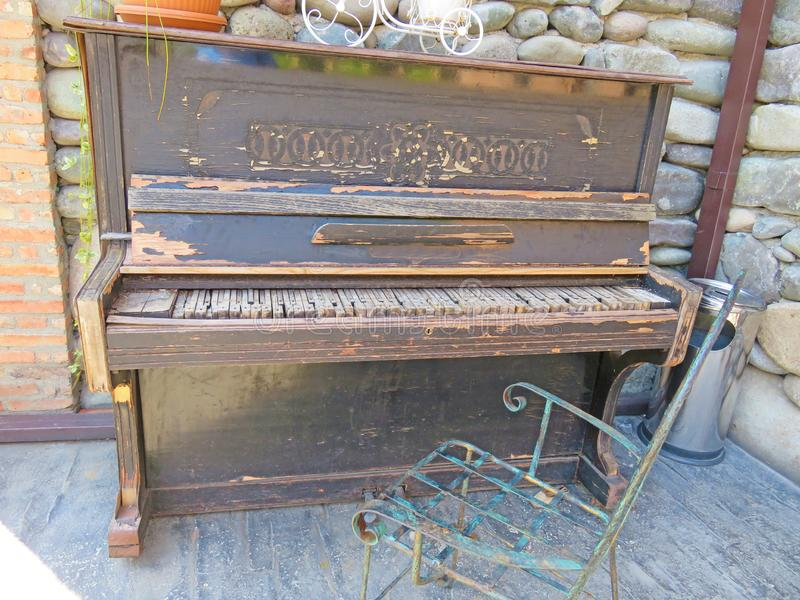 Old wooden piano. Vintage piano. Old royalty free stock image