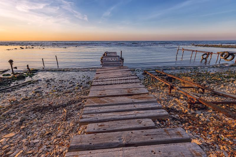 Old wooden pier at the fishing harbor. royalty free stock photo