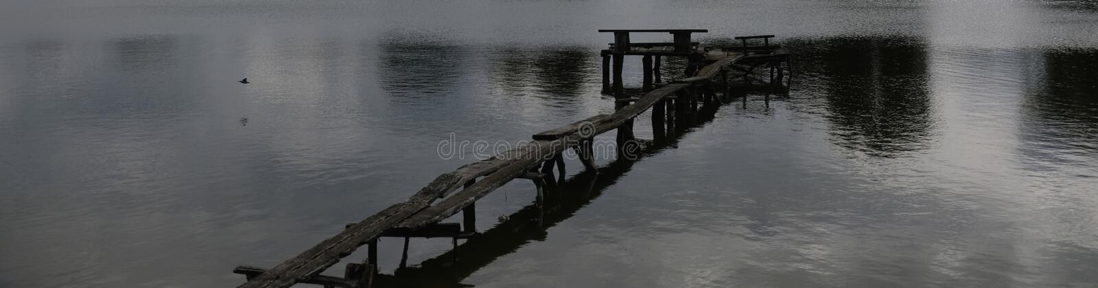 Old wooden pier over the lake.  royalty free stock photography