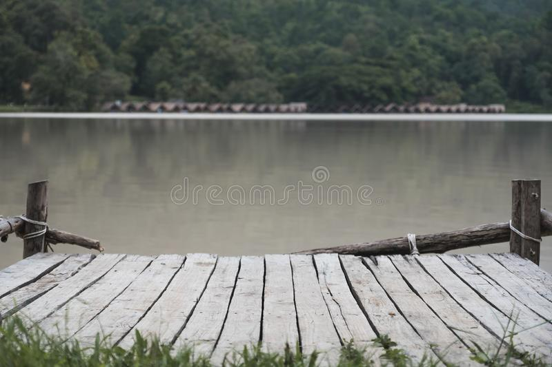 An old wooden pier by the river. Background royalty free stock image