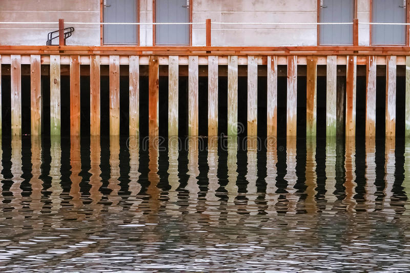 Old wooden pier wall stock images