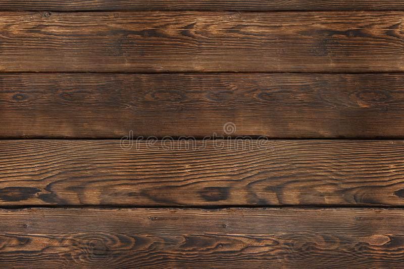 Old wooden plank background. Seamless texture. Vintage brown wood pattern, top view. stock photo