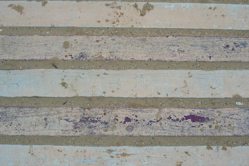 Old wooden planks in paint covered with sand. stock image