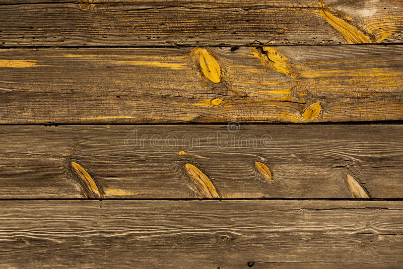 Old wooden planks. Old wooden planks, very visible wood grain and knots stock image