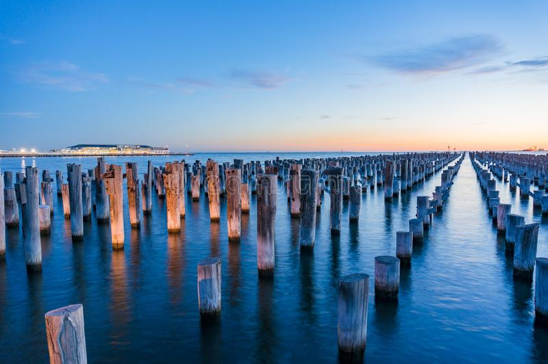 Old wooden pylons of historic Princes Pier in Port Melbourne. At dusk. Australia. Long exposure landscape photo stock photos